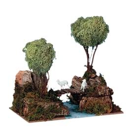 Alberi su roccia con gregge